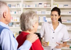 pharmacist serving elderly couple