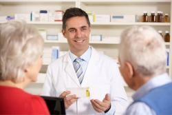 pharmacist assisting senior couple